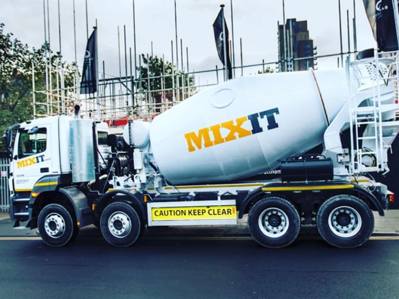 White concrete mixer with large yellow and grey Mixit branding
